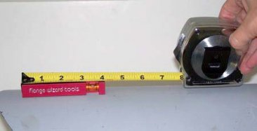 Magnetic Tape Holder in use with tape measure